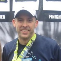 Picture of runner with medal after running the Atlanta Marathon